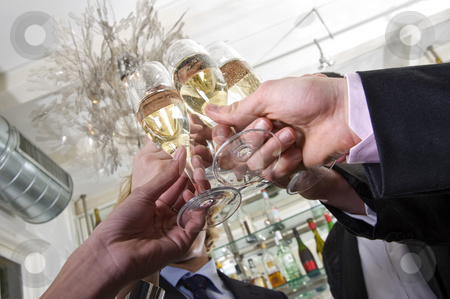 Toasting on new years eve stock photo, Several hands toasting with champagne on new years eve by Corepics VOF