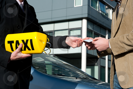 Getting the taxi license stock photo, A government official handing a taxi license and sign to a newly appointed taxi driver by Corepics VOF