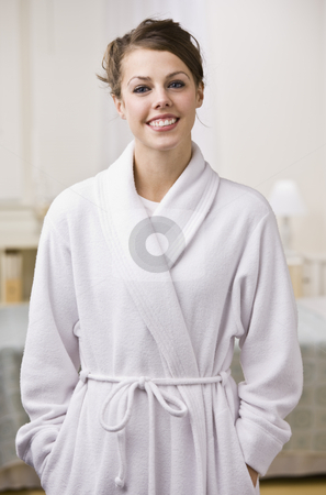 Attractive Brunette in Bathrobe stock photo, An attractive young woman wearing a bathrobe and smiling at the camera.  Vertically framed shot. by Jonathan Ross