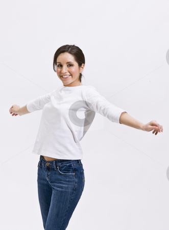 Cute Brunette Standing with Outstretched Arms stock photo, Attractive brunette woman standing and smiling with her arms outstretched. Vertically framed photo. by Jonathan Ross
