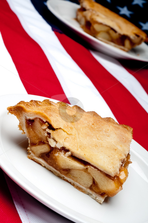 Shallow focus tilted vertical image of 2 pcs of apple pie on the stock photo, Shallow focus tilted vertical image of 2 pcs of apple pie on the American flag by Vince Clements
