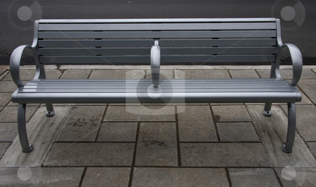 Modern street bench stock photo, A modern metal street bench on a downtown sidewalk by Fabio Katz