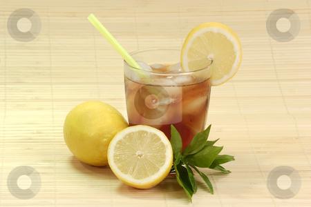 Lemon ice tea_10 stock photo, A glass full of Ice Tea with a lemon slice on bright background by Birgit Reitz-Hofmann