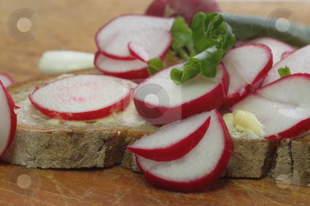 Radish bread stock photo, Fresh radish bread with spring leek as background by Birgit Reitz-Hofmann