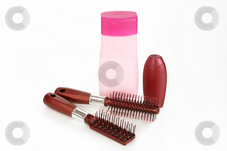 Hair shampoo stock photo, Shampoo and hairbrush on bright background by Birgit Reitz-Hofmann