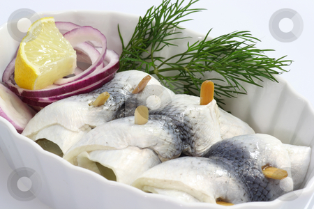 Rolled herring stock photo, Rolled herring in a bowl on bright background by Birgit Reitz-Hofmann