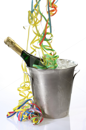 Party with champagne stock photo, Champaigne bottle in a cooler with ice and streamers on bright background by Birgit Reitz-Hofmann