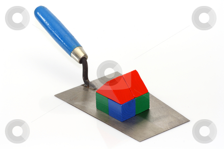 Construction stock photo, Trowel with toy bricks on bright background by Birgit Reitz-Hofmann