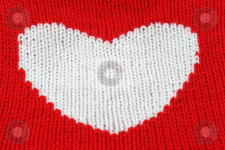 Heart stock photo, Close up from white knitting heart on red. by Birgit Reitz-Hofmann