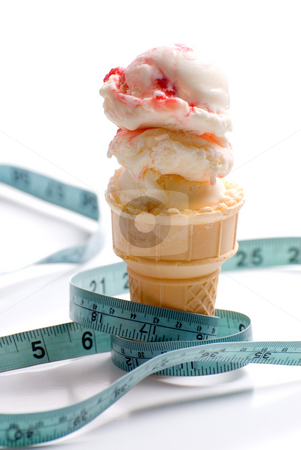 Diet stock photo, Concept image of a diet featuring an ice cream cone with strawberry ice cream and a measuring tape shot on white by Richard Nelson