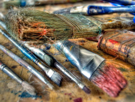 Used burshes stock photo, Closeup of used colored brushes  in some art studio. by Sinisa Botas