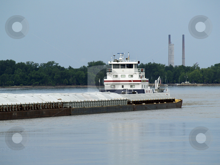 Tugboat  stock photo, A tugboat and bardge traveling south down the Mississippi River. by W. Paul Thomas