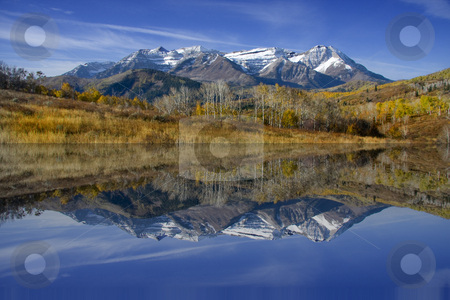 Fall Refelctions stock photo, High mountain lake in the fall showing autumn colors reflected in the water