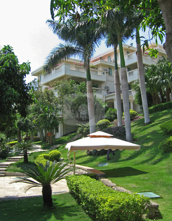 Beautiful front lawn of tropical resort stock photo,  by Shi Liu
