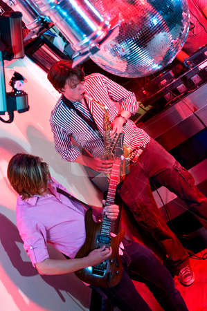 Performance stock photo, The performance of a saxophonist and a guitarist in a nightclub. by Corepics VOF