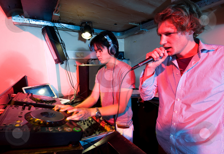 Dj in action stock photo, A DJ and a mc in action at a party in a nightclub. by Corepics VOF