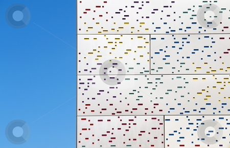 Metal facade and sky stock photo, Detail of modern metal facade with color mosaic and blue sky by Juraj Kovacik