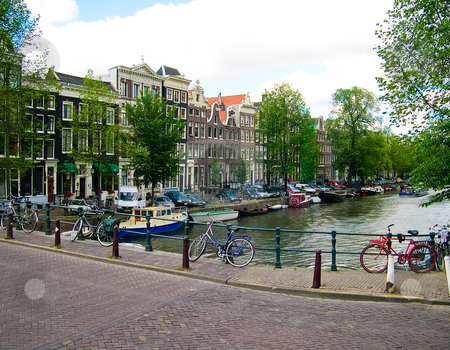 Amsterdam canal  stock photo, Buildings, canal and boats in Amsterdam by Jaime Pharr