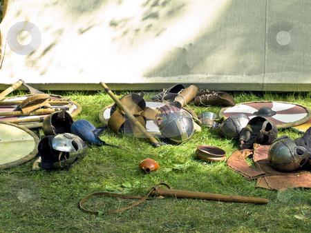 Armor stock photo, Scattered metallic armor at the green grass by Sergej Razvodovskij