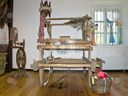 Loom stock photo, Old wooden loom in the center of the room by Sergej Razvodovskij