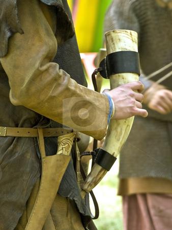 Drinking horn  stock photo, Drinking wine horn in the hands of  warrior by Sergej Razvodovskij