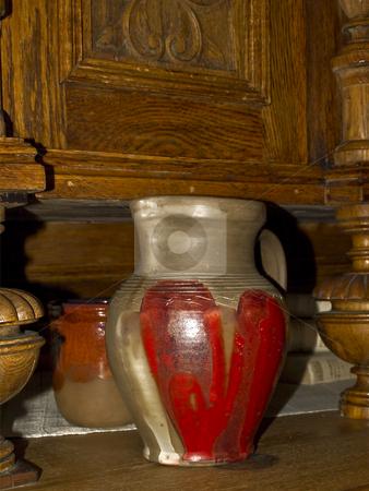 Ceramic pitcher stock photo, Ceramic pitcher at the old oak sideboard by Sergej Razvodovskij