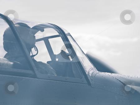 In the sky stock photo, Close up photo of airplane cockpit in the sky through the smoke by Sergej Razvodovskij