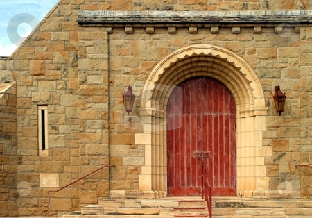 Old Church Door stock photo, Old wooden red church door entrance with stone wall. by Henrik Lehnerer