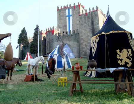 Medieval castle stock photo, Medieval castle and tents on a horse tournament by Marc Torrell