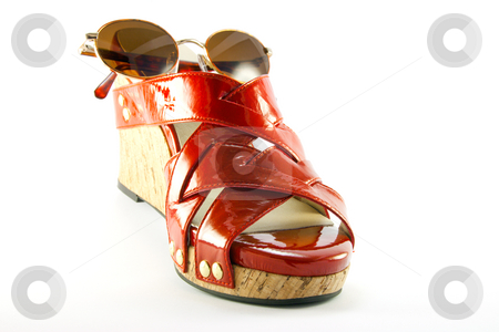 Red Shoe and Sunglasses stock photo, Single red shoe and brown sunglasses with clipping path on a white background by Keith Wilson