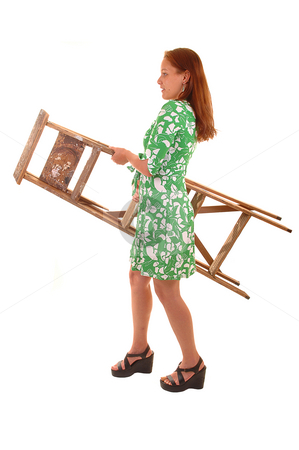 Girl caring stepladder. stock photo, Young woman in green dress and high heels caring a stepladder, for white background. by Horst Petzold