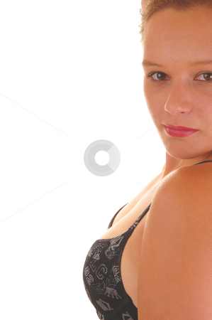 Woman in black bra. stock photo, Young woman shooing her chest with an black bra with her small breasts in close up on white background. by Horst Petzold