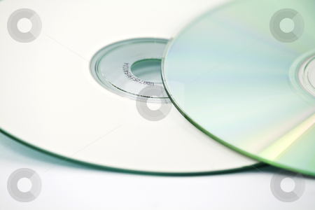 Two CDs -close up stock photo, Two CDs, one on top of another, one up-side down, isolated over white by Arek Rainczuk