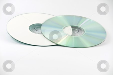 Two CDs stock photo, Two CDs, one on top of another, one up-side down, isolated over white by Arek Rainczuk