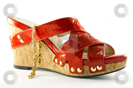 Red Shoe and Bracelet stock photo, Single red shoe and gold bracelet with clipping path on a white background by Keith Wilson