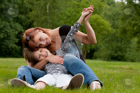 My happy mom and me stock photo, Mother and Daughter are happy in the park by Frenk and Danielle Kaufmann