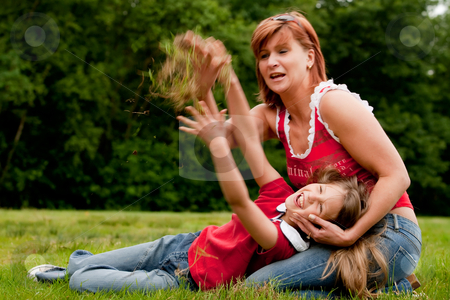 Lets threw some grass stock photo, Mother and Daughter are happy in the park by Frenk and Danielle Kaufmann