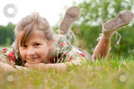 Sweet child in the grass stock photo, Young talented girl is posing like a little model by Frenk and Danielle Kaufmann