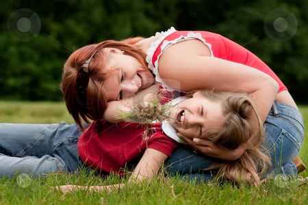 We eating grass stock photo, Mother and Daughter are happy in the park by Frenk and Danielle Kaufmann