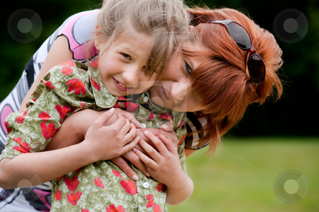 Sweet mother and daugther portrait stock photo, Mother and Daughter are happy in the park by Frenk and Danielle Kaufmann