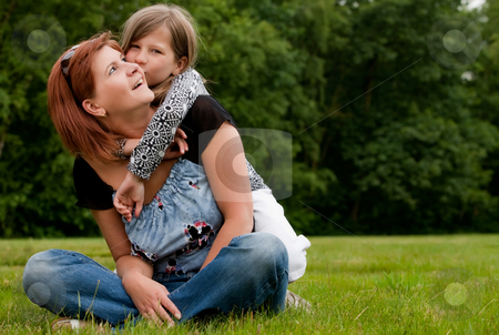 Kissing my mom stock photo, Mother and Daughter are happy in the park by Frenk and Danielle Kaufmann