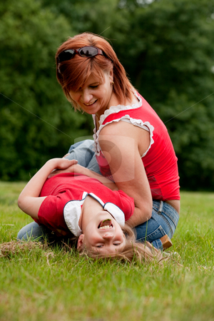 Smiling with my mother stock photo, Mother and Daughter are happy in the park by Frenk and Danielle Kaufmann
