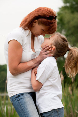 Child and mothers moment stock photo, Mother and Daughter are happy in the park by Frenk and Danielle Kaufmann