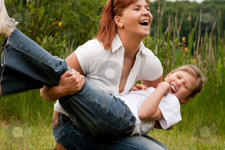 Throw my girl stock photo, Mother and Daughter are happy in the park by Frenk and Danielle Kaufmann