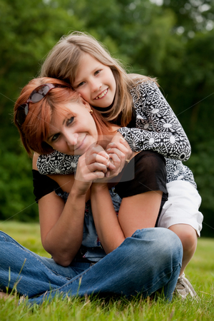 Happy girl with her mom stock photo, Mother and Daughter are happy in the park by Frenk and Danielle Kaufmann