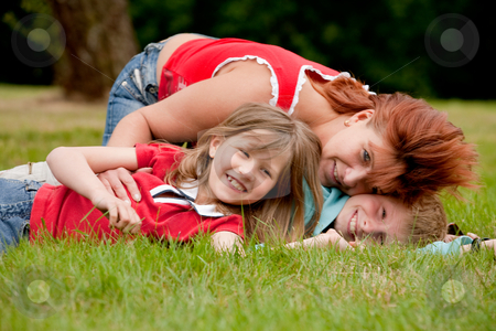 Me my mother and my brother stock photo, Mother and her kids are happy in the park by Frenk and Danielle Kaufmann