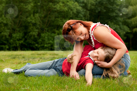 Playing with my daugther stock photo, Mother and Daughter are happy in the park by Frenk and Danielle Kaufmann
