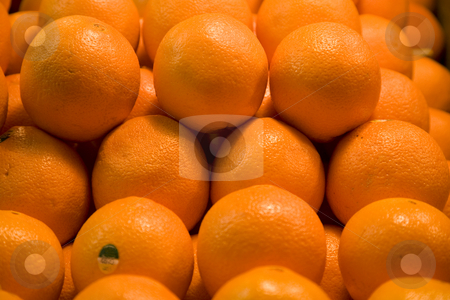 Bright Oranges stock photo, Pile of Bright Oranges FruitTrademark removed. by William Perry