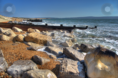 Coastal Sea Defence stock photo, HDR Image of Groynes protecting  the coast with rugged  rocks in foreground by Robert Ford