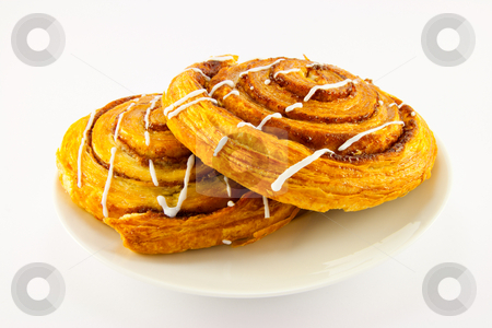 Two Cinnamon Buns stock photo, Two iced cinnamon buns with clipping path on a white background by Keith Wilson